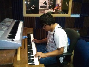 A student from DHDC plays the piano.