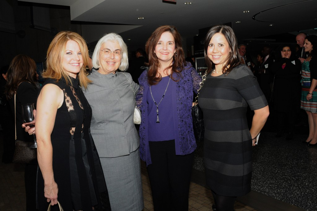 Laurie Sall, Laurie Sall & Associates; Sylvia Gucken, The Ideal Group; Cindy Cordoba-Koziol, General Motors; and Linzie Venegas, Ideal Shield. DHDC supports pose together at 2013 Dream Makers' Gala, sponsored by General Motors Supplier Diversity.